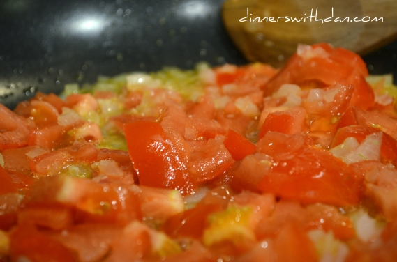 Tomatoes, onion, and garlic cooking down.